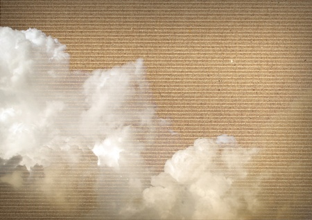 White clouds over a brown paper cardboard texture Stock Photo