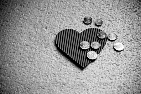 Paper heart and little coins euro