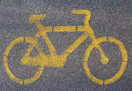 Yellow cycle signal on asphalted bicycle lane Stock Photo