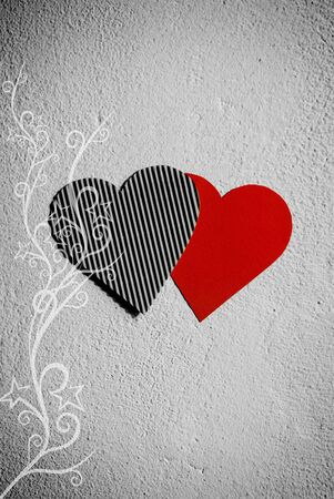 Paper hearts hanging on the wall Stock Photo