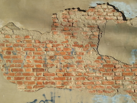 Background image of a cracked red bricks wall