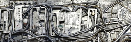 Old electronic equipment assembled in a Technological junk panel Stock Photo
