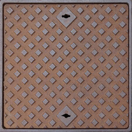 Image of a old squared rusty manhole Stock Photo