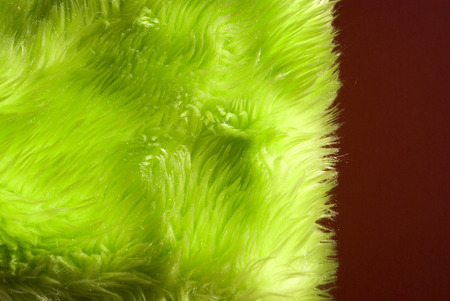 Close-up background of a green synthetic fur