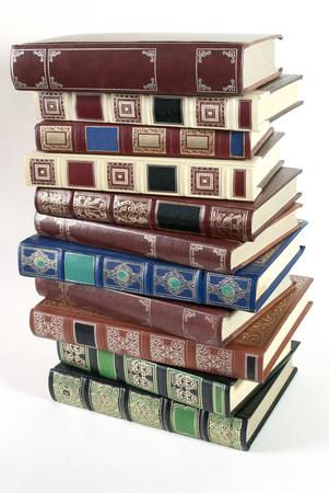 Stack of hardback books isolated on white background