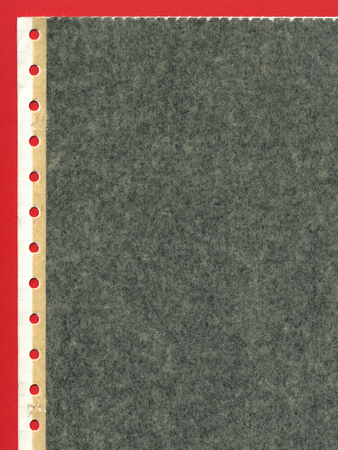Perforated carbon copy paper over red background