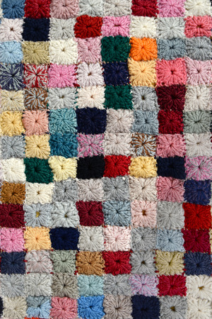 Colorful handcrafted patchwork quilt pattern (woolen yarn)