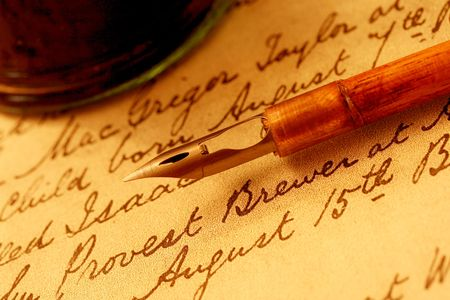 handled: Vintage wooden-handled nib pen and inkwell, on a page of 18th century script. Stock Photo