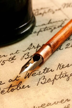 18th: Vintage nib pen and inkwell, on a page of 18th century script. Stock Photo