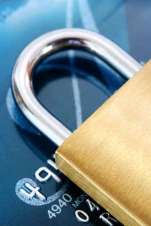 creditcard: Security:  Brass padlock on credit card.