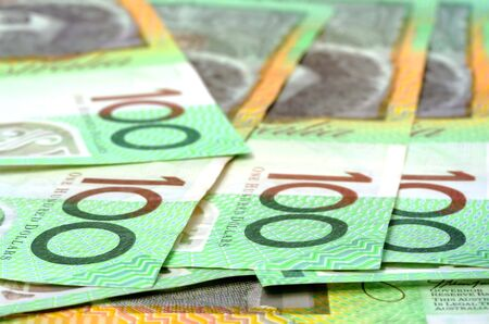 Australian $100 notes.  Shallow depth of field.