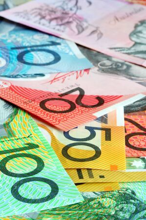 foreign currency: Australian money - notes form a full-fram background, with focus on front notes.