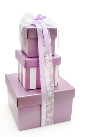 mauve: Pretty mauve gift boxes in a stack, tied with white and mauve ribbons.