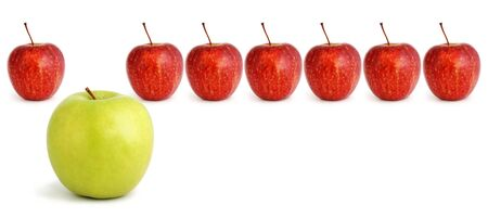 include: Standing out from the crowd...green apple stands out from a row of red apples.  Business concepts include leadership, individuality, creativity, lateral thinking.