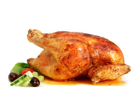 Golden roasted chicken, ready to serve. Stock Photo