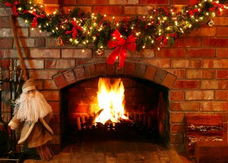 christmas fireplace: Christmas garland and lights over a log fire, with Santa as a helper.