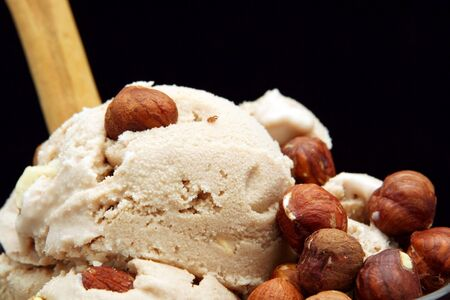hazelnut: Hazelnut Icecream, with whole and chopped hazelnuts, and a cinnamon stick.