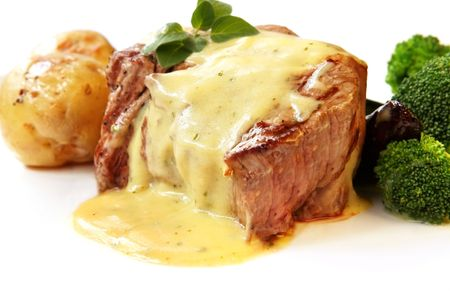 Filet Mignon ~ perfectly grilled thick-cut beef steak, with bearnaise sauce,  roast potatoes, and broccoli.