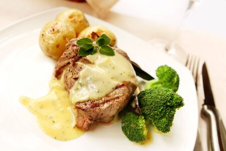 rib eye: Filet mignon ~ thick-cut rib eye fillet beef steak, grilled to perfection with bearnaise sauce and vegetables.