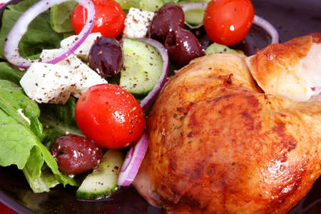 cos: Roast chicken and Greek salad, with cos lettuce, red onion, black olives, grape tomatoes, fetta cheese, and herbs.