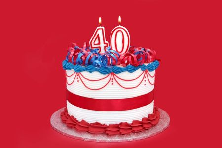 public celebratory event: 40th cake with numeral candles, on vibrant red background.
