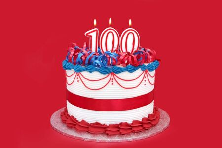 public celebratory event: 100th cake with numeral candles, on vibrant red background