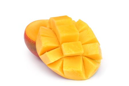 halved  half: Luscious mango, with one cheek cut into a hat.  Isolated on white.