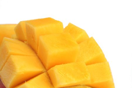 halved  half: Luscious mango, cut into a hat.  Closeup, isolated on white.