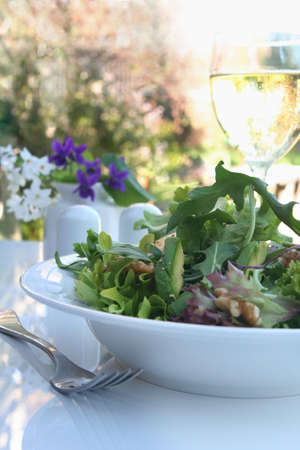 croutons: Salad, al fresco, with avocado, walnuts, croutons, and mixed greens.