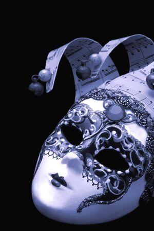 cyan: Venetian mask, on black, with cyan tone. Stock Photo