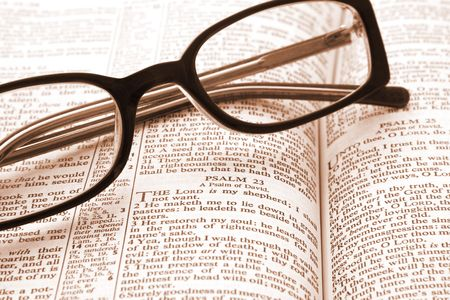 Bible open to Psalm 23, with reading glasses. photo