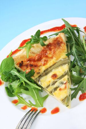 Asparagus quiche with rocket and  spinach, and sweet chili dressing. photo