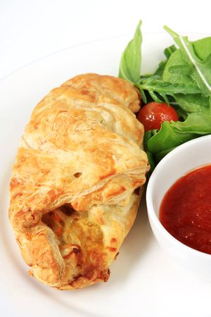 pasty: Cornish pasty with salad and sauce.  This is a type of vegetarian pie from Cornwall, also popular in Australia.