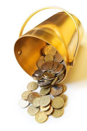 bucket of money: Golden bucket spilling coins.