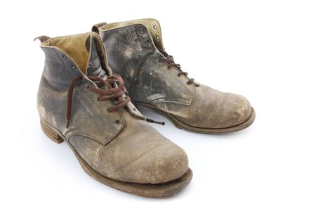 dirty man: Old work boots, 1940s vintage and worn until recent years.