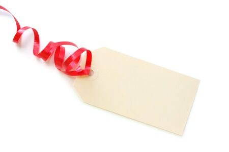 Blank gift tag tied with red curly ribbon. Stock Photo - 1928498
