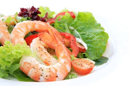 Prawn salad, with mixed greens, tomatoes and peppers, and king-size shrimp. photo