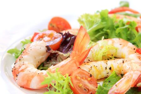 Prawn salad.  Simple and healthy salad of shrimp, mixed greens and tomatoes.