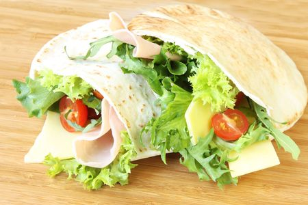Pitta bread pockets filled with salad, ham and cheese. Stock Photo - 1929247
