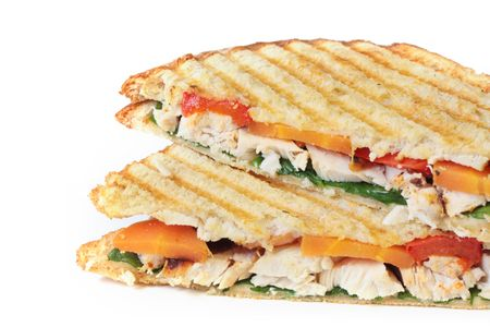 chicken sandwich: Toasted chicken and vegetable sandwich, isolated on white.  Fresh roasted chicken, red bell peppers, carrots, and spinach. Stock Photo