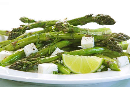accompaniment: Fresh asparagus salad with fetta cheese, spring onions and lime.   Stock Photo