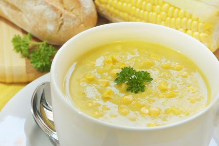Corn and parsley soup ~ a warming meal, with fresh sourdough bread. Stock Photo