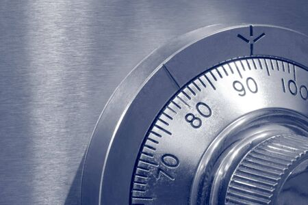 combination: Closeup of combination safe lock ~ blue duotone.