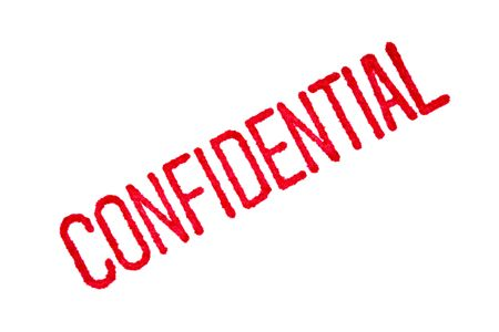confidentiality: Closeup of a red confidential stamp on white paper, with the red ink bleeding into the paper.