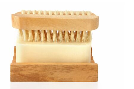 antibacterial soap: Soap in a wooden soap dish, with nail brush.  A hygiene message!