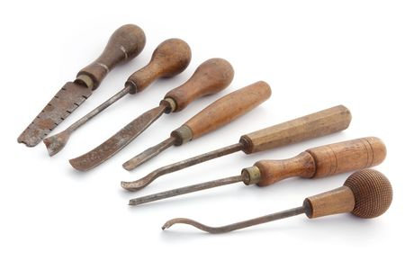 whittle: Vintage woodworking tools, isolated on white.  Well-used for many years for whittling, carving and other fine woodwork.