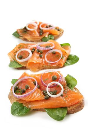 smoked salmon: Smoked salmon appetizer.  Smoked salmon,  spinach, red onion, capers and dill on toasted rye bread.  Serve with cream cheese, creme fraiche or sour cream on the side!