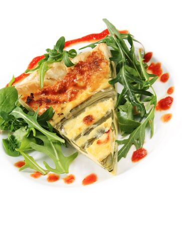 Asparagus quiche with salad and chili sauce, isolated on white. photo