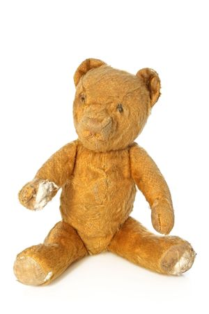 bruised: Vintage teddy bear, sitting.  Isolated on white.  Hes battered and bruised, but well-loved.