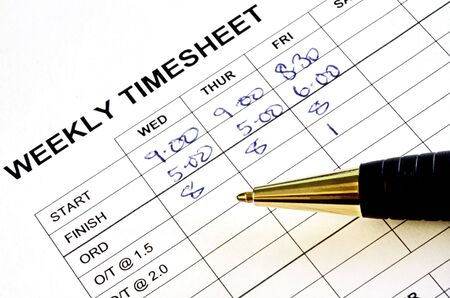 Weekly timesheet, with pen.  Timekeeping record. Stock Photo - 2328211